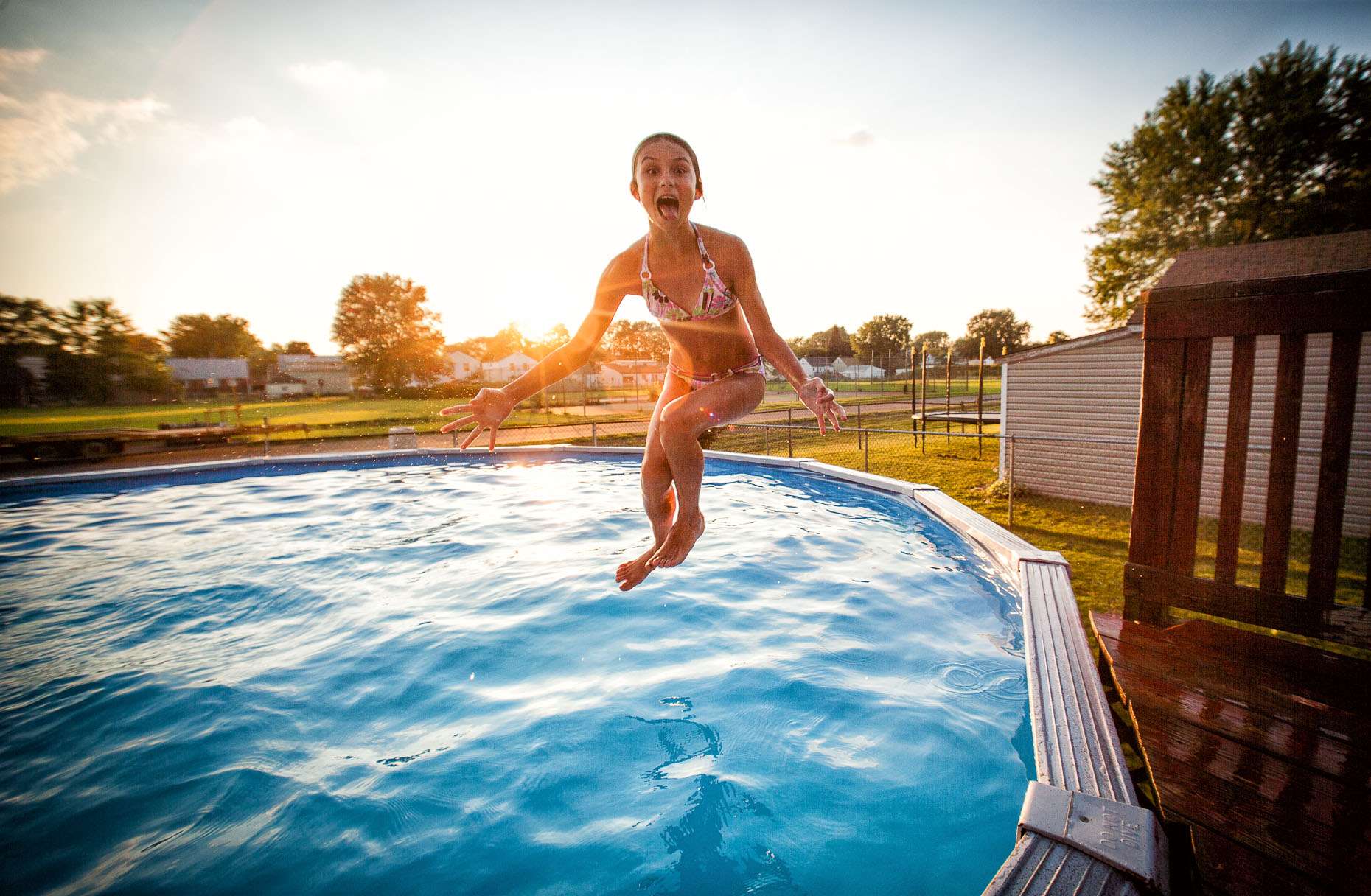 aaron-ingrao-Child-Swimming-pool-sunset-sunflair-playing-6
